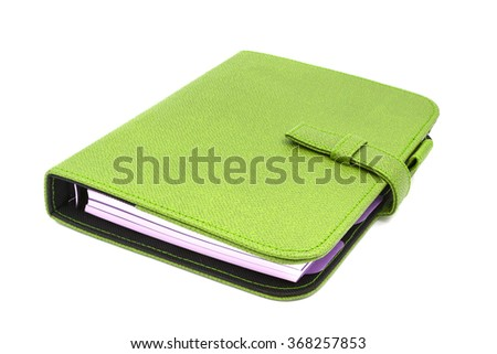 Green leather business diary isolated on white background