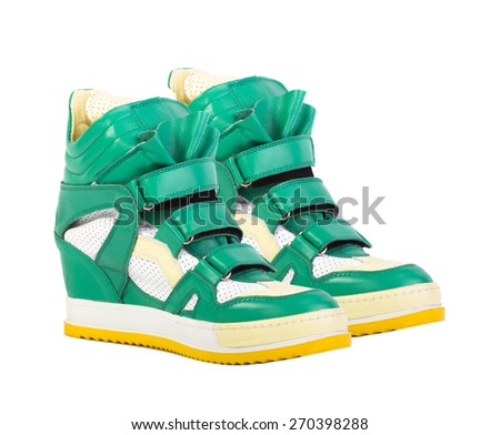 Green leather platform sneaker isolated on white background
