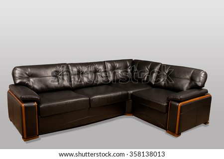 Green leather sofa on a gray background in the studio