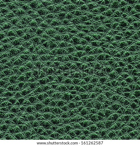 green  leather texture close up. Useful as background for design-works.