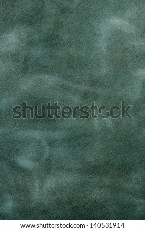Green leather texture closeup background.