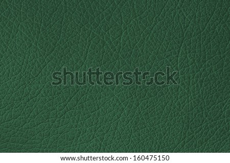 Green leather texture closeup, useful as background - stock photo