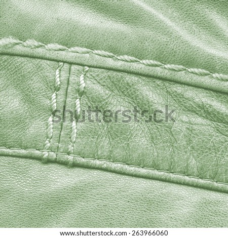 green leather texture, seams. Useful as background