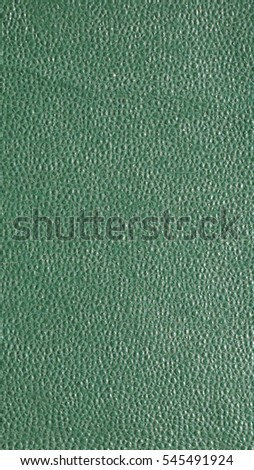 Green leatherette texture useful as a background - vertical