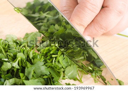 green leaves of parsley isolated on chopping board