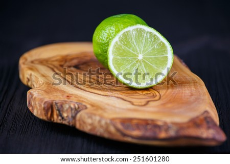 green lemons on the wooden table - stock photo