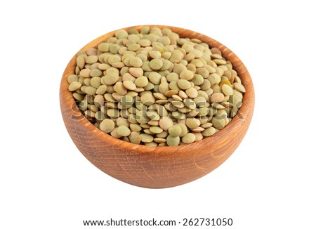Green lentil in wooden bowl, isolated on white background - stock photo