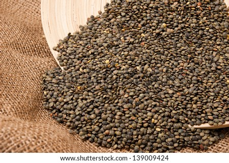 Green lentils in a wood tray,