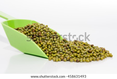 Green lentils on white background