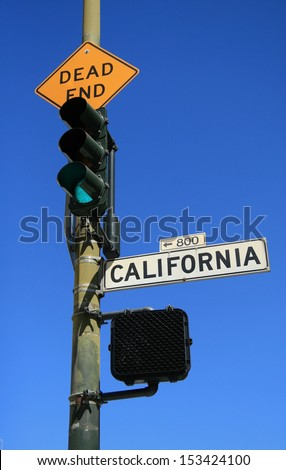 Green light at Dead End and California street traffic signs - stock photo