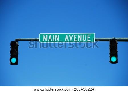 Green light at traffic lights on main avenue in Durango, Colorado, USA - stock photo