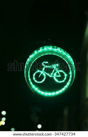 Green light for bicycle lane on traffic light - stock photo