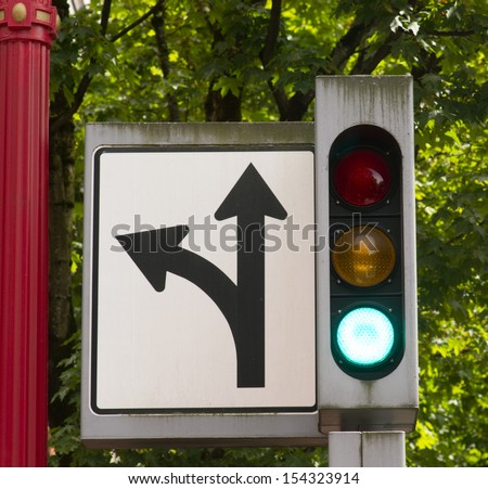 Green light for go on downtown traffic signal - stock photo