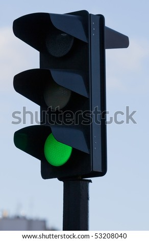 Green light on black traffic signal. small GRIP - stock photo