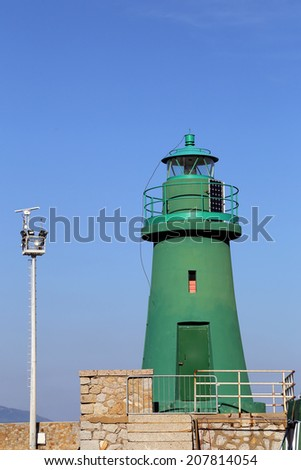 Green  lighthouse in the Gilio Island. Tuscany - Italy