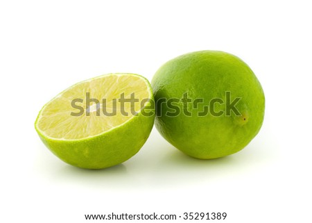 Green lime and its half isolated on white background.