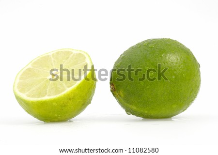 green limes on white background