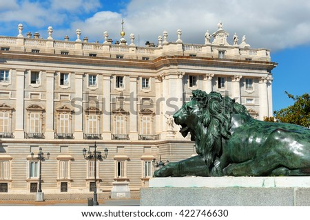 Green Lion in front of royal palace in madrid - stock photo