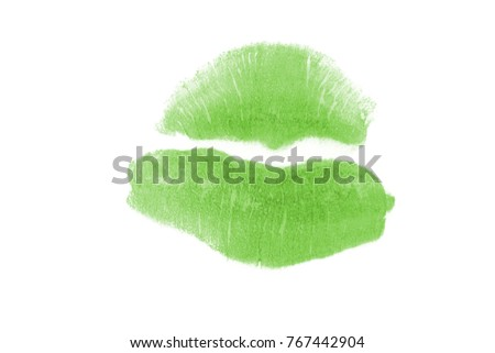 Green lipstick kiss on white background. Real lips print closeup