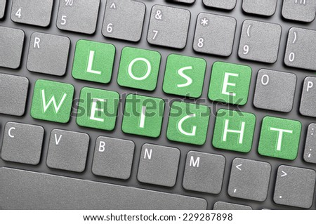 Green lose weight key on keyboard - stock photo