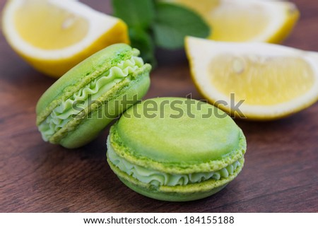 Green macaroons with lemon and mint - stock photo