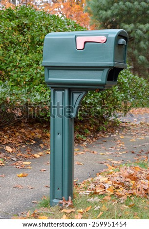 Green Mailbox autumn leaves - stock photo