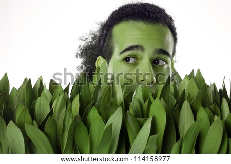 Green man pops out of grass