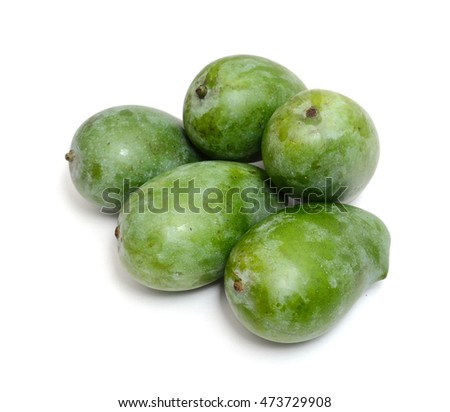 Green mangoes isolated on white