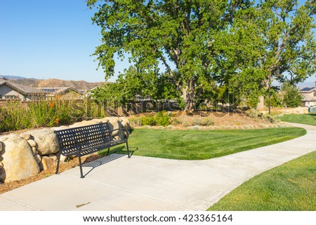 Green manicured grass lawn in garden area of suburban neighborhood park. - stock photo