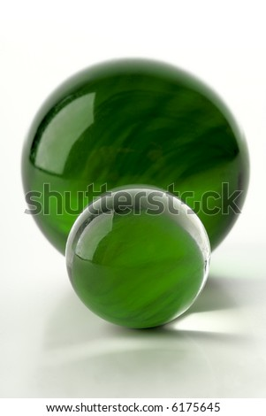 green marbles on white