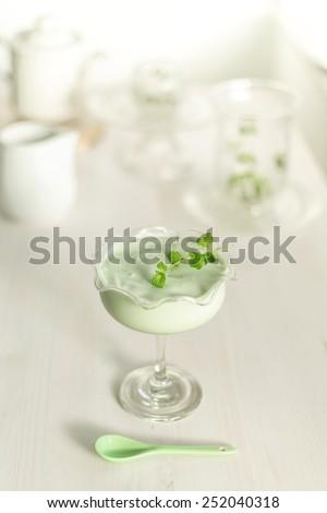 green match, pistache avocado vanilla and a little white chocolate, natural ingredient milkshake  - stock photo
