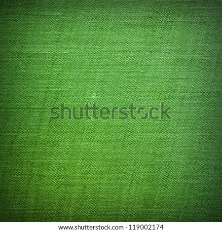 Green material texture or background - stock photo