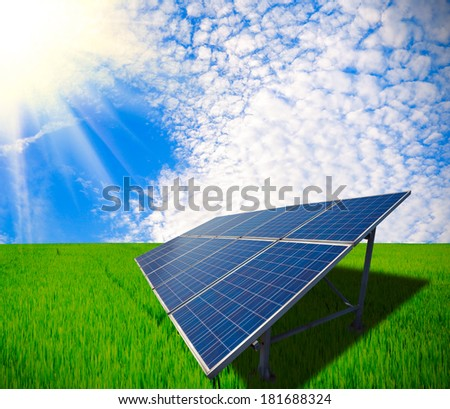 Green meadow at energy and sustainable development of solar energy - stock photo