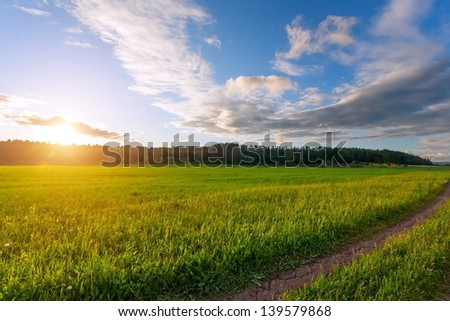 green meadow on a sunset (Russia) - stock photo