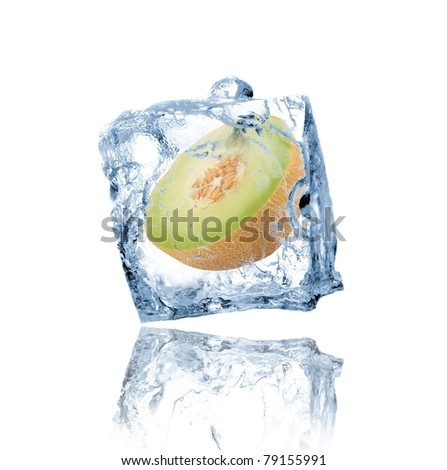 Green melon frozen in ice cube - stock photo