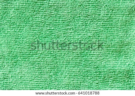 Green microfiber fabric texture background. Microfiber is recyclable synthetic fiber made from petrochemicals includes polyester and nylon, the thread is smaller than the diameter of a strand of silk.