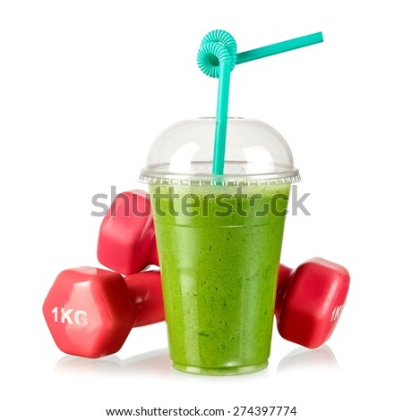 Green milk smoothie with two pink dumbbells  - stock photo