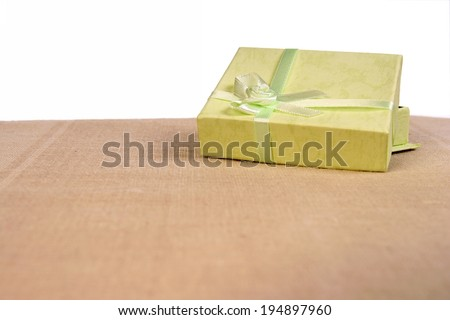 Green mini gift box with ribbon isolated on white background - stock photo