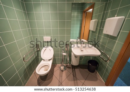 green, modern bathroom for the disabled