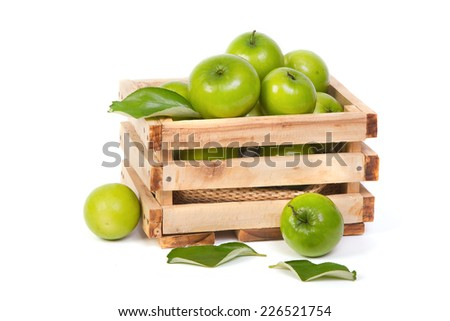 Green Monkey apple or jujubes in wooden crate - stock photo