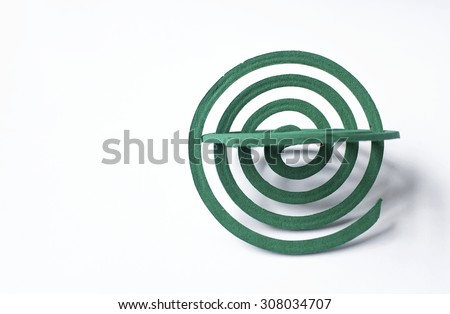Green mosquito repellent coils on white background