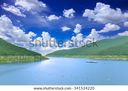 green mountain and clouds on blue sky on top of DAM. - stock photo