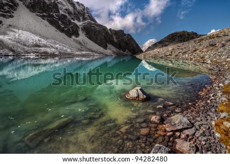 Green mountain lake black ridge reflection - stock photo