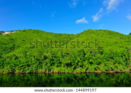 Green mountain on blue sky