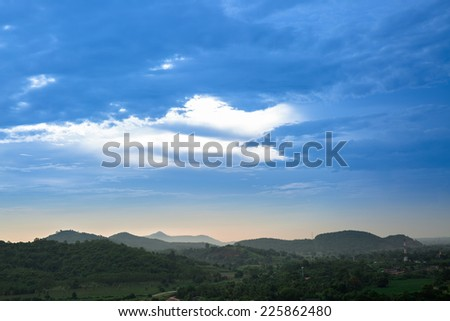 Green mountains and blue sky in early morning - stock photo