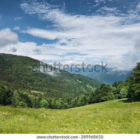 Green mountains and blue sky with clouds - Svydovets range, Carpathians, Ukraine - stock photo