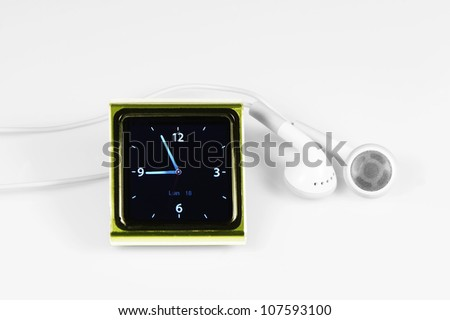 green MP3 player with headphone - stock photo