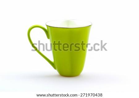 Green mug on a white background - stock photo