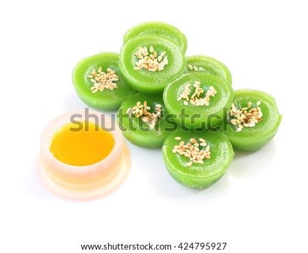 Green multiple scented sesame chinese sweet and liquid sugar on white floor.