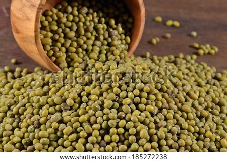 Green mung beans in a wooden bowl